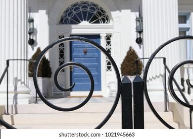 Wrought iron and blue door