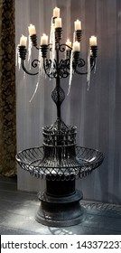 Wrought iron candelabra with 12 branches candle holders