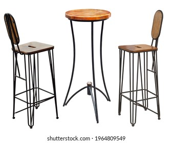Wrought iron chair and table isolated on a white background. Chairs made of metal and wood close up. Set of garden furniture.