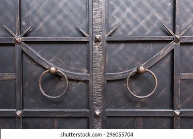 wrought iron doors. with circular handle