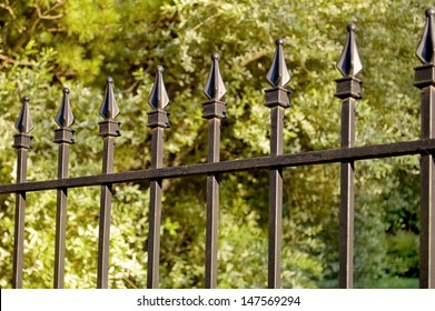 A wrought iron fence with very shallow depth of field./Iron Fence