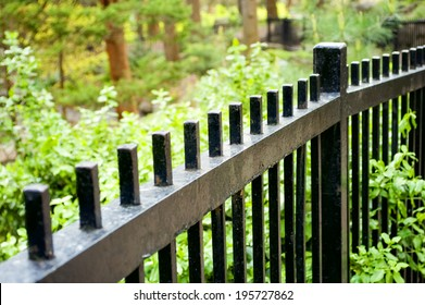 A wrought iron fence with very shallow depth of field./wrought iron fence
