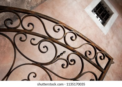 Wrought iron gate and wall background in Provence