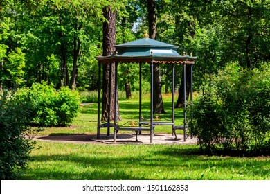 Wrought iron gazebo in a park at summer