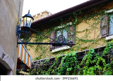 A wrought iron lamp on a wall