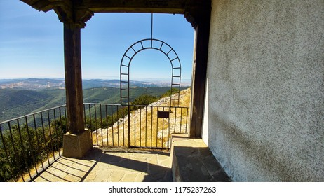Wrought iron semi-circular arch in the viewpoint of a hermitage