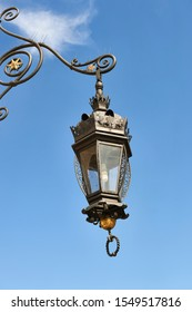 wrought iron street lamps over blue sky in the main square of Krakow