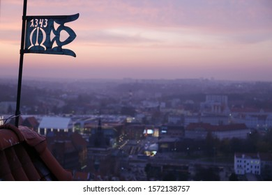 wrought iron vintage flag with number 1343 against sunset sky, Gdansk, Poland