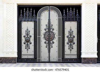 Wrought metal  gates . Front of the house.