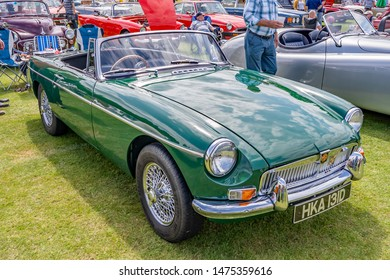 Wroxham, Norfolk, UK – July 21 2019. Front and side view of a classic MG Midget sports car on display at the annual classic and vintage car show at Wroxham, Norfolk, UK