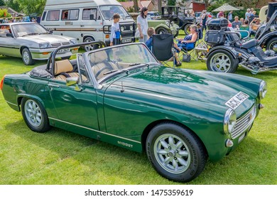 Wroxham, Norfolk, UK – July 21 2019. Front and side view of a vintage MG Midget sports car on display at the annual classic and vintage car show in Wroxham, Norfolk, UK