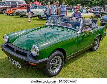 Wroxham, Norfolk, UK – July 21 2019. Front view of a classic MG Midget sports car on display at the annual classic and vintage car show at Wroxham, Norfolk, UK
