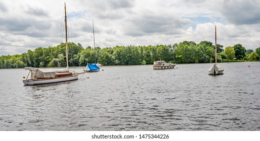 Wroxham, Norfolk, UK – June 01 2019. Privately owned sailing boats and craft moored up on Wroxham Broad, Norfolk