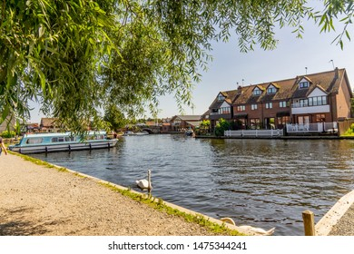 Wroxham, Norfolk, UK – June 01 2019. A pretty holiday riverside holiday let on the banks of the River Bure in the village of Wroxham in the heart of the Norfolk Broads.