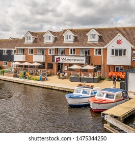 Wroxham, Norfolk, UK – June 01 2019. Wherryman's Bar and Café on the bank of the River Bure in the village of Wroxham, Norfolk