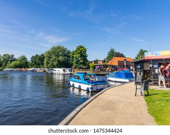 Wroxham, Norfolk, UK – June 01 2019. A view down the public moorings on the River Bure in the village of Wroxham in the heart of the Norfolk Broads