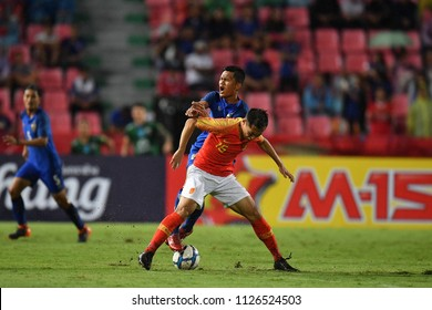 Wu Xi No.15 (red) of China in action during 2018The International Friendly Match between Thailand and China at the Rajamangala Stadium on June 2, 2018 in Bangkok,Thailand,