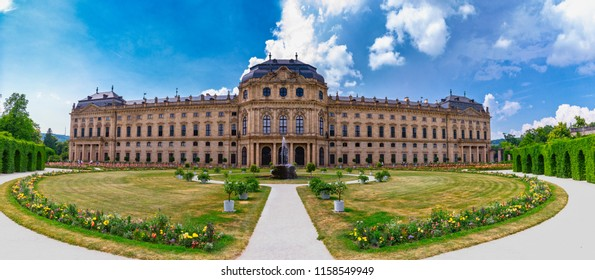 Wuerzburg, Germany - June 10, 2018 -  Panorama view of the Würzburg Residence from garden with colorful flowers in foreground, a Baroque style palace in Würzburg, Bavaria, Germany