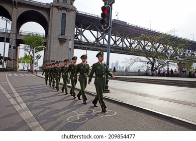 WUHAN, CHINA - APRIL 15: Squad marches on a road near the Changjiang Bridge on April 15, 2013 in Wuhan, China