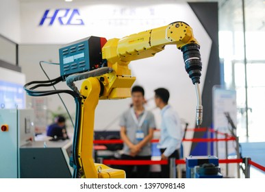 Wuhan, China - May 10, 2019: intelligent welding robot from FANUC (FANUC), Japan, at the China international advanced automobile manufacturing technology conference.
