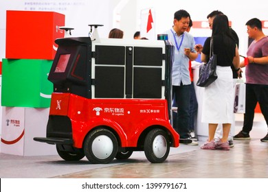 """Wuhan, China - May 10, 2019: jd logistics displays intelligent logistics of unmanned warehouse intelligent handling robot (AGV) at wuhan international e-commerce and """"Internet +"""" industry expo."""