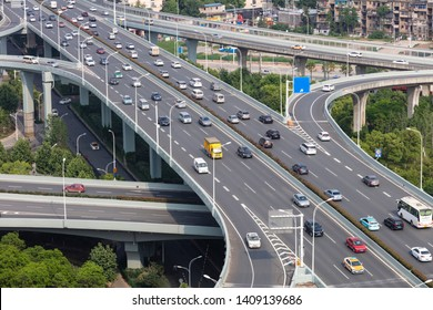 Wuhan, China - May 10, 2019: a busy traffic flow on the ma ying road overpass viaduct, next to rows of high-rise commercial buildings and residences. China has more than 200 million cars.