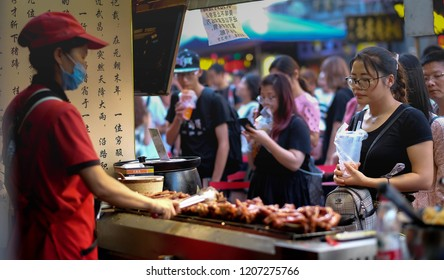WUHAN CHINA-September 8 , 2018:  One woman who sell meet grill. It's famous food in here.