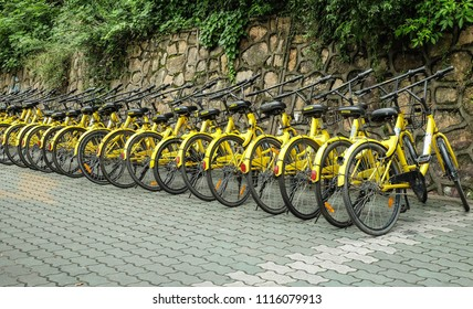 WUHAN, HUBEI CHINA - MAY 20, 2018: Row of yellow bicycles ,OFO free sloating bicycle rental in China.