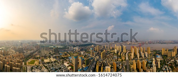 Wuhan skyline and Yangtze river with supertall skyscraper under construction in Wuhan Hubei China.