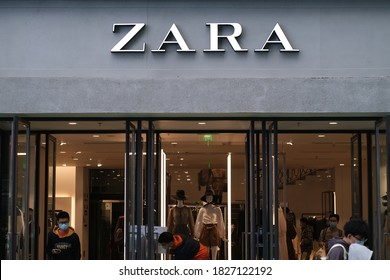 Wuhan/China-Oct.2020: facade of ZARA store with customers. Chinese people in face mask shopping in ZARA. A fast-fashion retail brand from Spain.