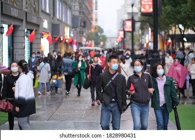 Wuhan/China-Oct.6th 2020:people in face mask to prevent coronavirus, walking on Jianghan Road. Jianghan Road is a famous commercial street in Wuhan