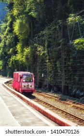 Wulai, Taiwan - January 14, 2018:  Wulai Scenic Train runs along the miniature railway in Taipei County, Taiwan. Its famous for hot springs and aboriginal culture. It is popular among local & tourists