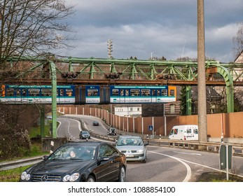 "Wuppertal, Nordrhein-Westfalen, Germany. 15.01.2012. Monorail ""Die Schwebebahn"", built 1901,  crossing the motorway A46  in Wuppertal-Sonnborn."