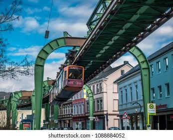 """Wuppertal, Nordrhein-Westfalen, Germany. 15.01.2012. Monorail """"Die Schwebebahn"""", built 1901,  running overhead the Kaiserstrasse in Wuppertal-Vohwinkel."""