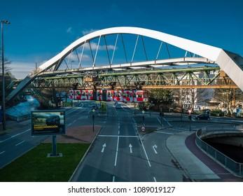 "Wuppertal, Nordrhein-Westfalen, Germany. 15.01.2012. Monorail ""Die Schwebebahn"", built 1901,  crossing the Bundesallee  in Wuppertal-Elberfeld."
