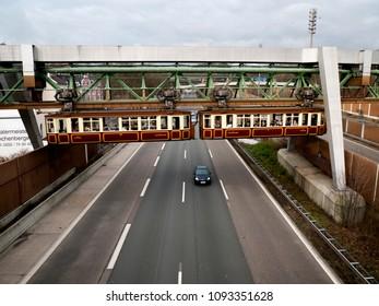 "Wuppertal, Nordrhein-Westfalen, Germany. 15.01.2012. Monorail ""Die Schwebebahn"" crossing the motorway A46  in Wuppertal-Sonnborn, Germany."