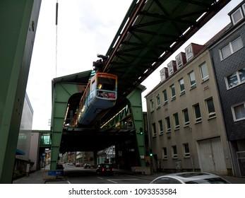 "Wuppertal, Nordrhein-Westfalen, Germany. 15.01.2012. Monorail ""Die Schwebebahn"", built 1901,  leaving a station in Wuppertal-Sonnborn, Germany."