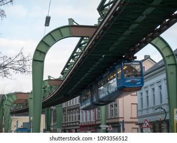 "Wuppertal, Nordrhein-Westfalen, Germany. 15.01.2012. Monorail ""Die Schwebebahn"", built 1901,  running overhead the Kaiserstrasse in Wuppertal-Vohwinkel, Germany."