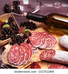 Wurst, Fuet, Sausage smoked sliced on black background. Delicatessen.