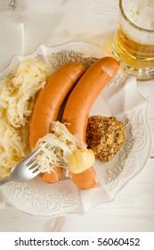 wurstel with sauerkraut and mustard  on dish