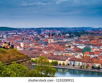 WURZBURG, GERMANY - JULY 22. 2018 : Unknown young people over aerial view of Wurzburg, Germany.