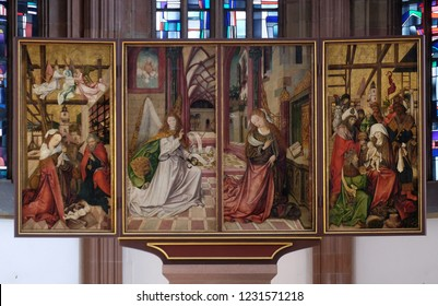 WURZBURG, GERMANY - JULY O4, 2018: The Annunciation and Nativity Scene, main altar in Marienkapelle in Wurzburg, Bavaria, Germany