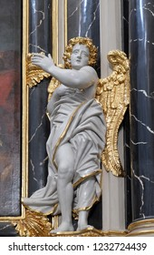 WURZBURG, GERMANY - JULY O4, 2018: Angel statue on the Provost's altar in Wurzburg Cathedral dedicated to Saint Kilian, Bavaria, Germany
