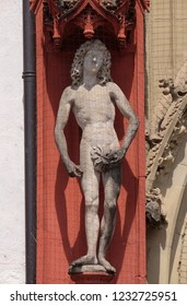 WURZBURG, GERMANY - JULY O4, 2018: Statue of Adam on the portal of the Marienkapelle in Wurzburg, Bavaria, Germany