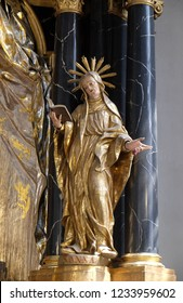 WURZBURG, GERMANY - JULY O4, 2018: Saint Anne statue on the Virgin Mary altar in the Neumunster Collegiate Church in Wurzburg, Germany