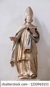 WURZBURG, GERMANY - JULY O4, 2018: Saint Burchard of Wurzburg, statue in Neumunster Collegiate Church in Wurzburg, Germany