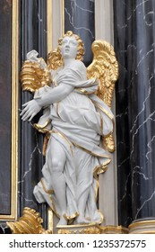 WURZBURG, GERMANY - JULY O4, 2018: Angel statue on the The Dean's Altar in Wurzburg Cathedral dedicated to Saint Kilian, Bavaria, Germany