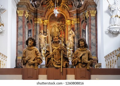 WURZBURG, GERMANY - JULY O4, 2018: Statues of thre Martyrs Kilian, Colman and Totnan, Neumunster Collegiate Church in Wurzburg, Germany