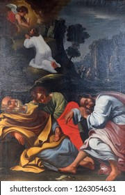 WURZBURG, GERMANY - JULY O4, 2018: Agony in the Garden, Jesus in the Garden of Gethsemane, the Apostles sleep, painting in the Neumunster Collegiate Church in Wurzburg, Germany