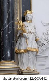 WURZBURG, GERMANY - JULY O4, 2018: Saint John Nepomuk statue on the The Dean's Altar in Wurzburg Cathedral dedicated to Saint Kilian, Bavaria, Germany
